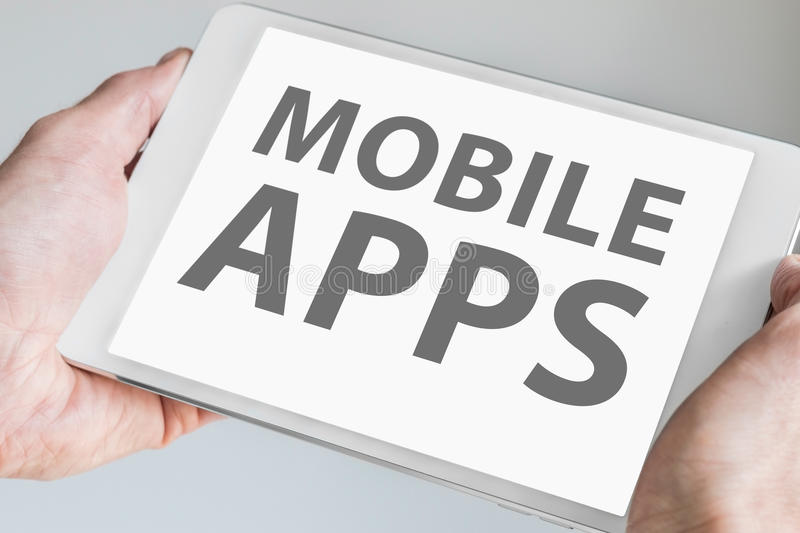Mobile apps text displayed on touchscreen of modern tablet or smart device. Concept for development of applications for mobile de royalty free stock photos