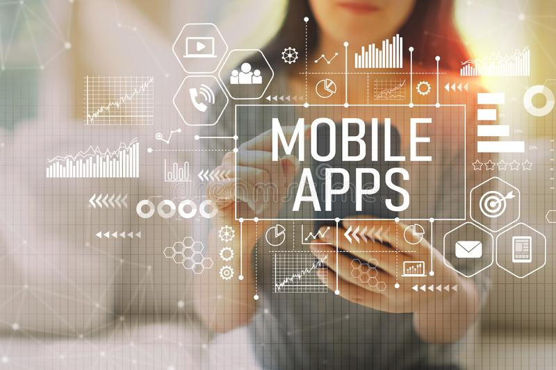 Mobile apps with woman using a smartphone stock photos