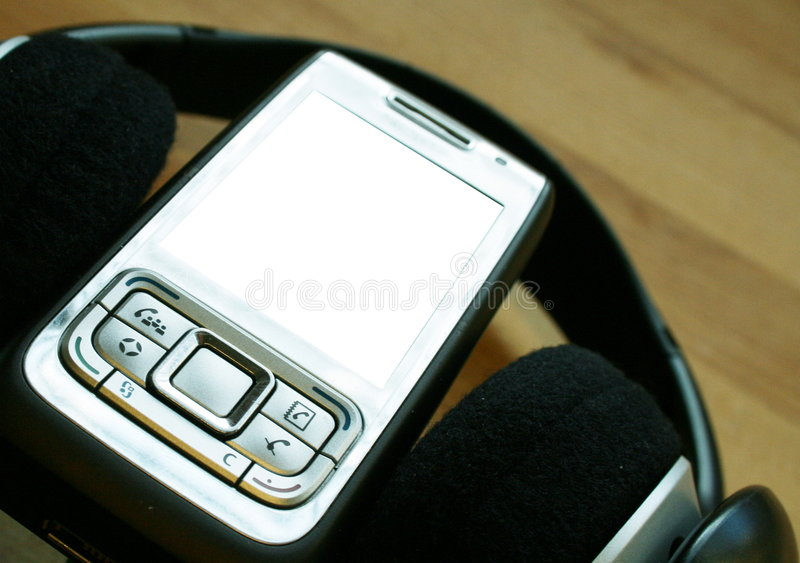 Mobile audio. A modern business like mobile phone inside a headset royalty free stock photography