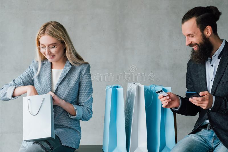 Mobile banking online shopping couple credit card royalty free stock photo