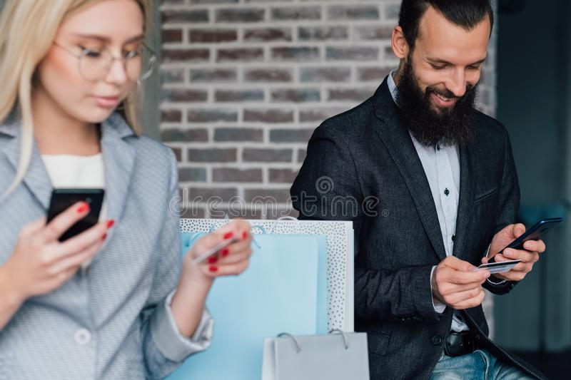 Mobile banking online shopping couple credit cards royalty free stock image