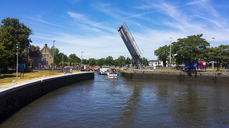 Mobile bridge rise up so that a cargo ship can pass. Picture take Bruges city from Belgium stock photography