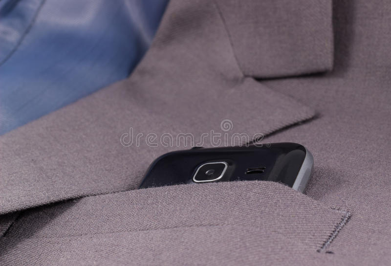 Mobile camera looks out of his jacket pocket. Is a business style royalty free stock images