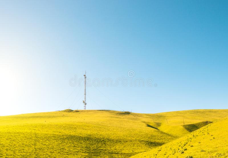 Mobile communications antenna on the hills stock photos