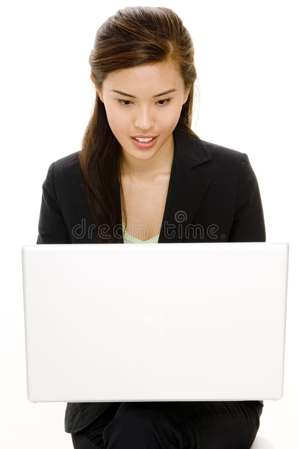 Mobile Computing. A young asian businesswoman using a laptop computer royalty free stock image