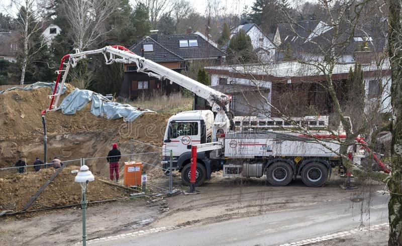 Mobile concrete pump at making the basement of a house royalty free stock image