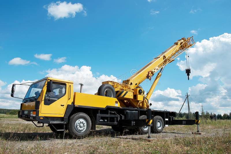 Mobile crane with risen boom royalty free stock photos