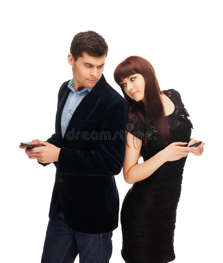 Mobile date. Attractive pair having mobile date on isolated white royalty free stock photography