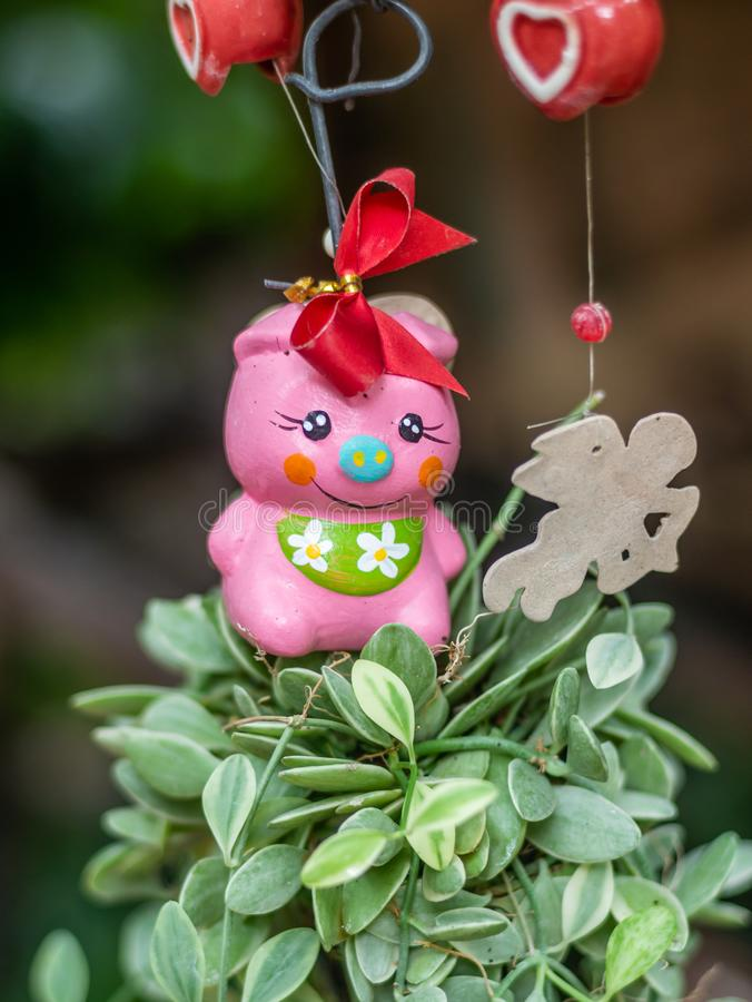 Mobile doll hanging in garden for decoration. Lovely mobile doll hanging in garden for decoration royalty free stock photo