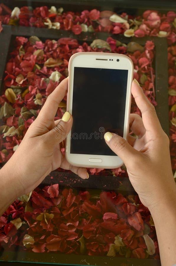Mobile en main photographie stock
