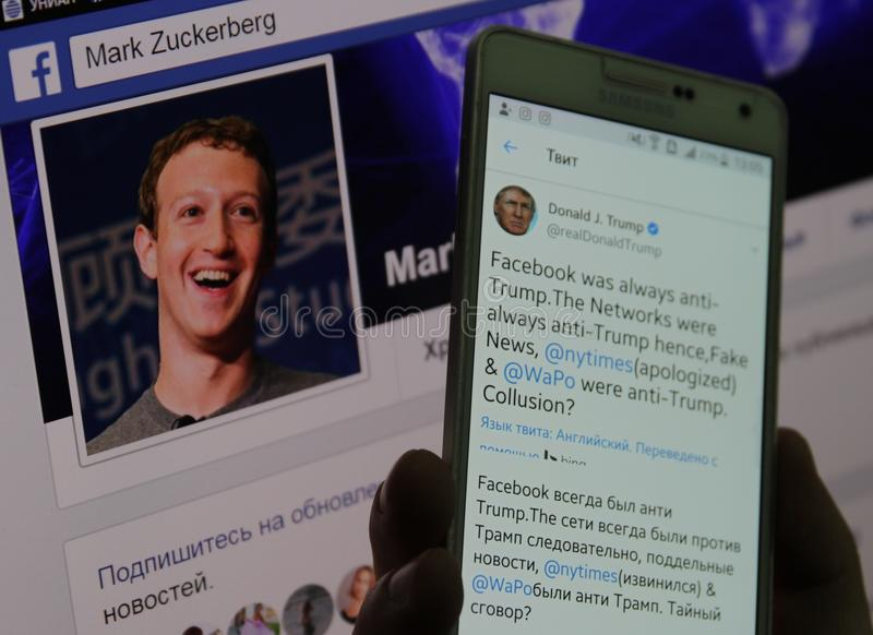 Mobile gadget with the page of the Donald Trump and page Mark Zuckerberg. stock image