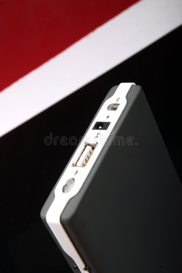 Mobile harddisk. A mobile harddisk in the red-white-black background royalty free stock photos