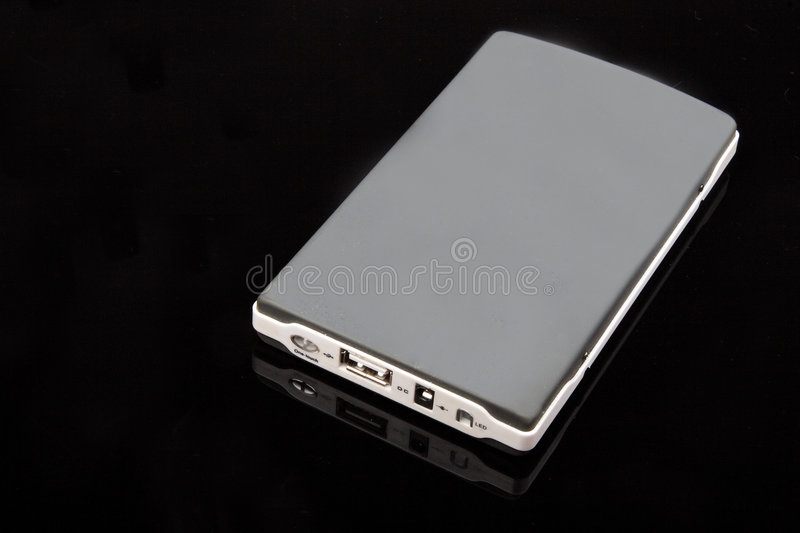 Mobile harddisk. A mobile harddisk in the black background royalty free stock image