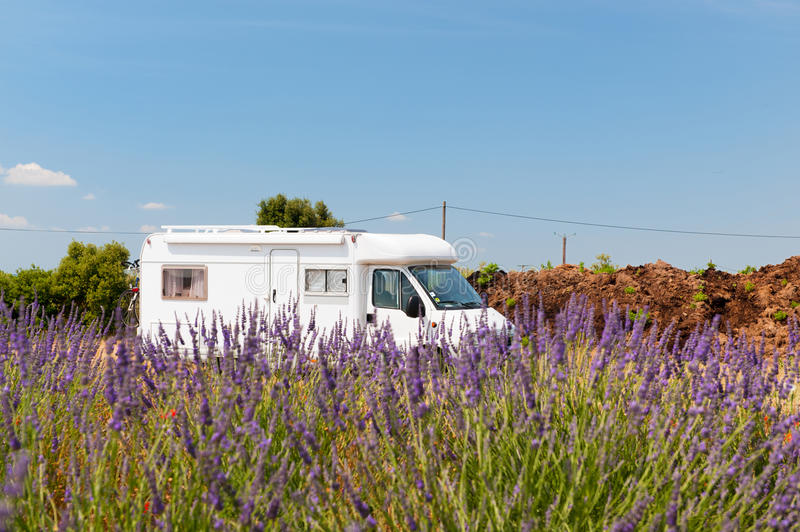 Mobile home in French lavender fields. Traveling with mobile home in the French Provence royalty free stock photography