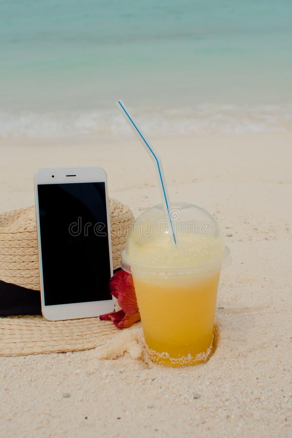 Mobile Internet anywhere in the world, concept. Using the Internet and your smartphone even on a remote tropical island. royalty free stock images