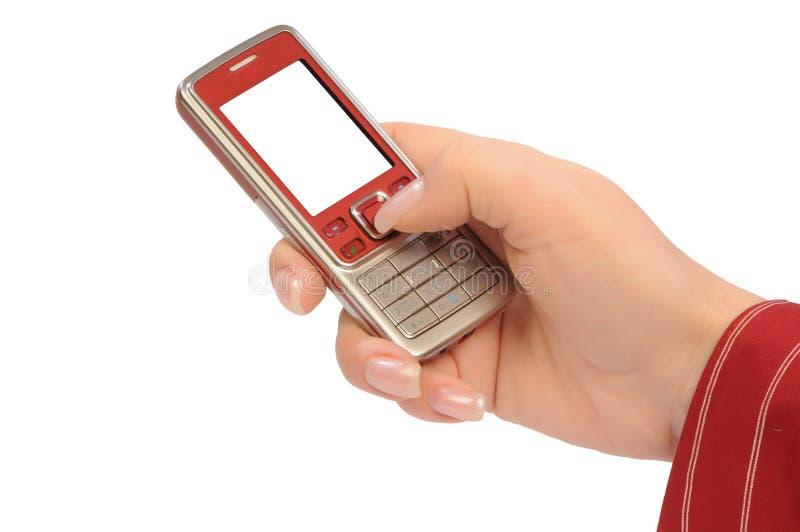Mobile in mano womanish immagine stock libera da diritti