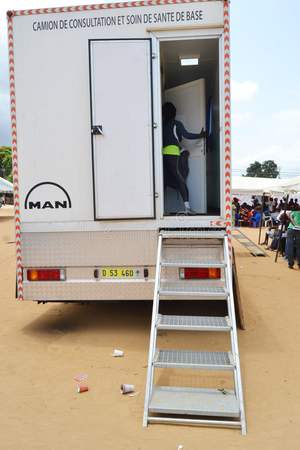 MOBILE MEDICAL CARAVAN. Caravan mobile medical volunteers providing free care to disadvantaged patients under the impetus of the Ivorian Minister of Health to royalty free stock photo