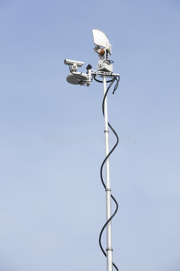 Mobile News Van Antenna. Vertical image of a news van uplink antenna on the scene stock photos