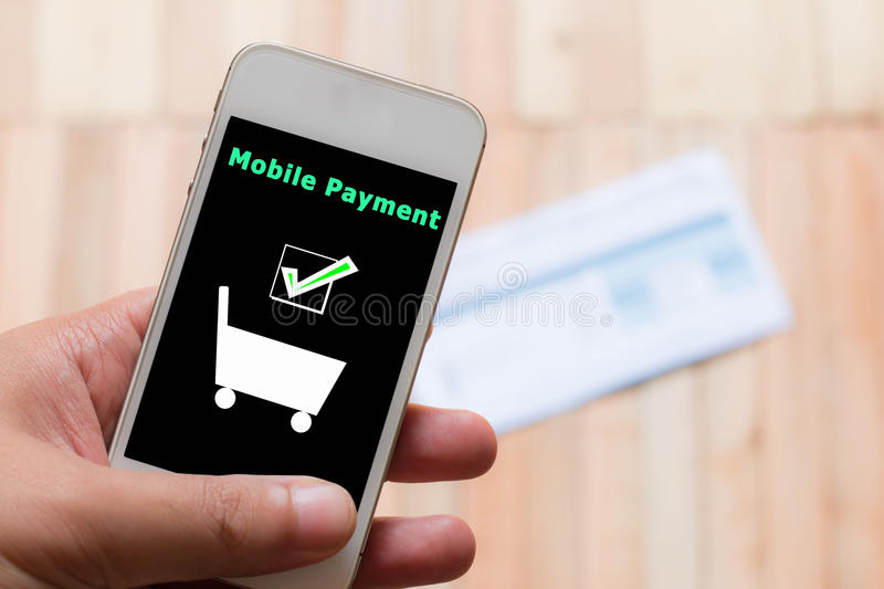 Mobile payment. With blur of bill background royalty free stock photography