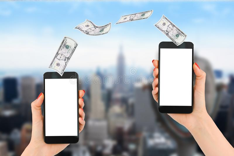 Mobile payment or money transfer with smartphone, Empire State Building and Financial District as background royalty free stock photo