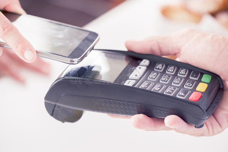 Mobile payment. NFC - Near field communication, mobile payment royalty free stock photos