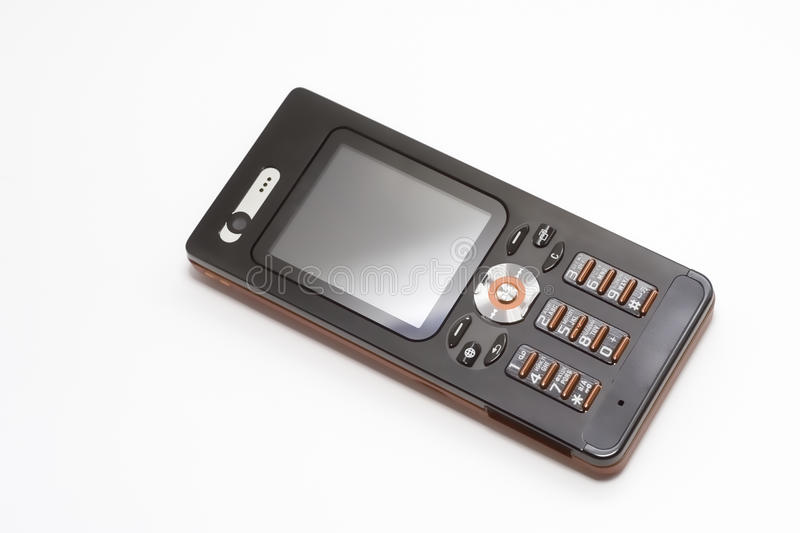 Mobile Phone. Black and red mobile telephone over white background royalty free stock photography