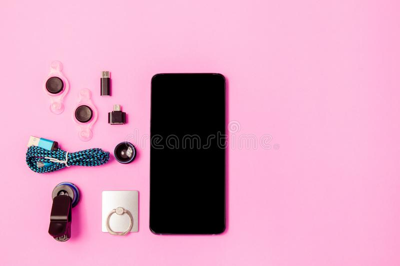Mobile phone and Accessory set technology Blank space on bright pink pastel background. Mobile phone and Accessory set technology Blank space on bright pink royalty free stock photos