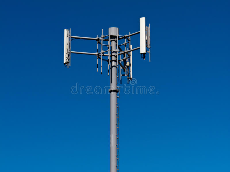 Download Mobile Phone Antennas On Metal Tower On Blue Sky Stock Photo - Image: 24800550