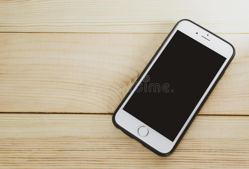 Mobile phone with blank screen on wooden. Floor background,Smart phone,Copy space,vintage style,Top view stock photo