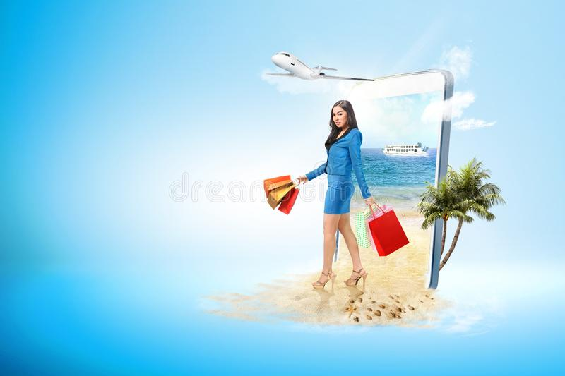 Asian business woman with shopping bag on the beach stock photos