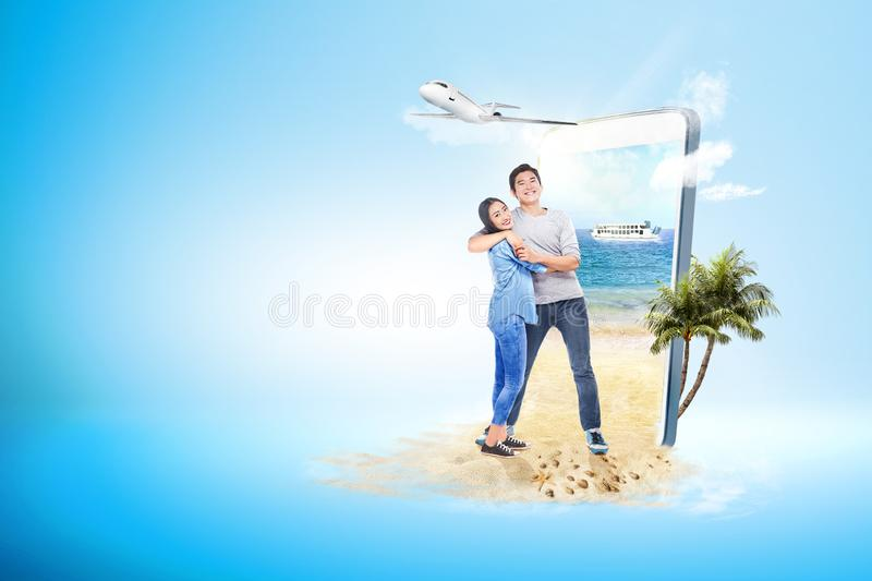 Asian couple hugging on the beach royalty free stock photography