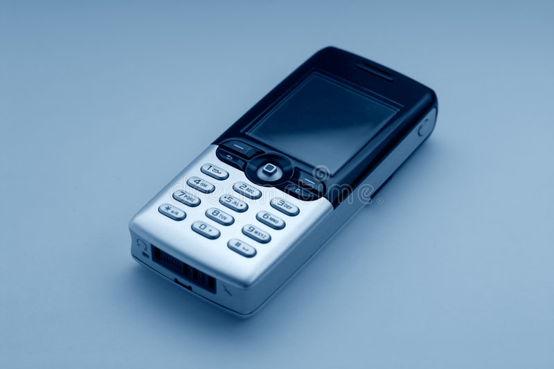 Mobile phone - blue tone stock images