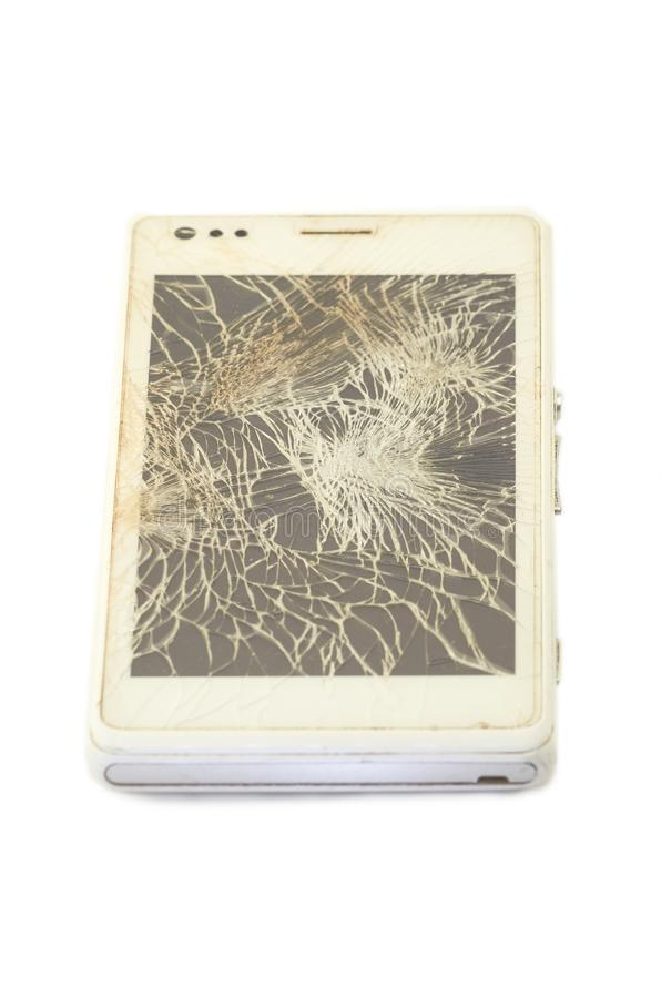 Mobile phone with broken screen, white smartphone royalty free stock image