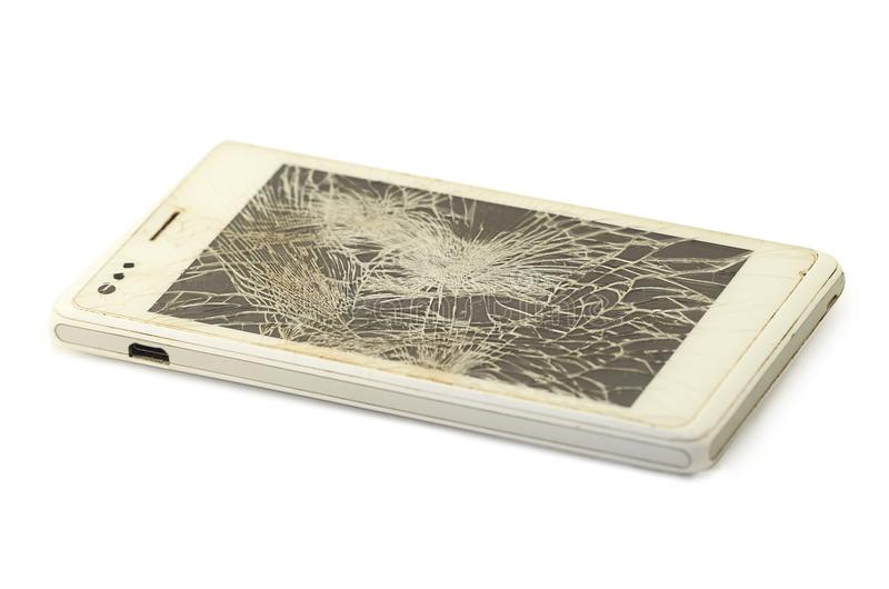 Mobile phone with broken screen, white smartphone royalty free stock photos