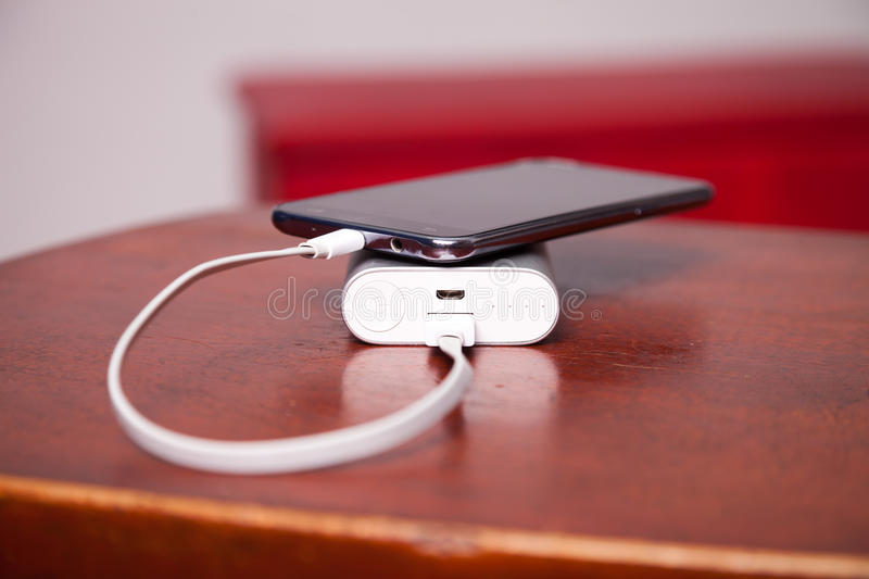 Mobile Phone Charging With Power Bank stock images