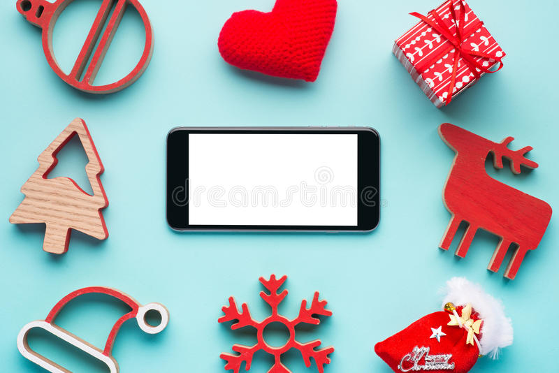 Mobile phone and the Christmas decoration stock image