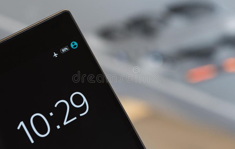 Mobile phone with clock stock images