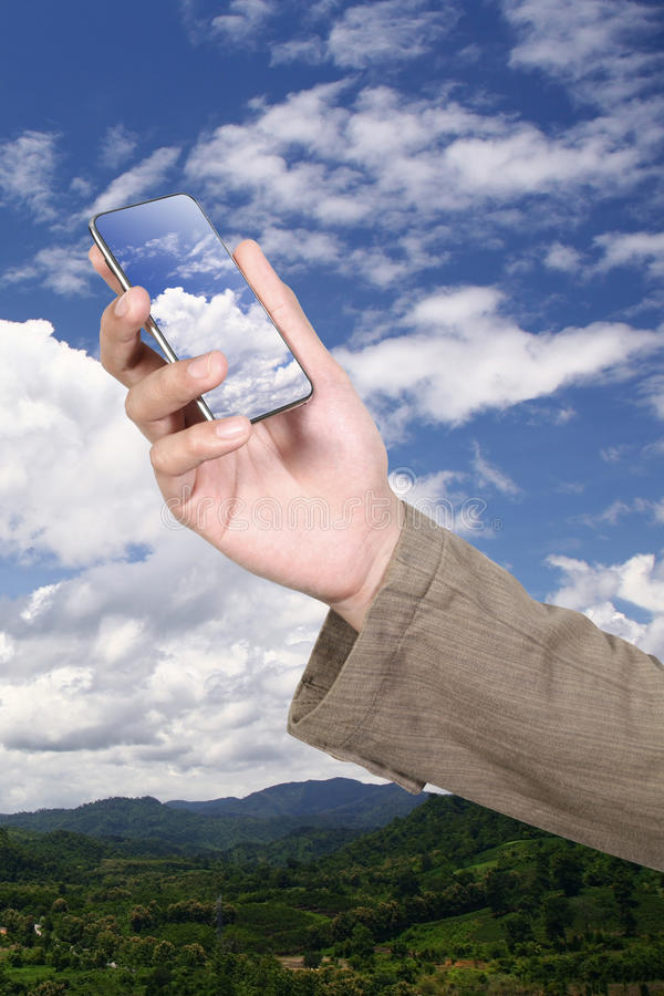 Mobile phone on cloud royalty free stock photography