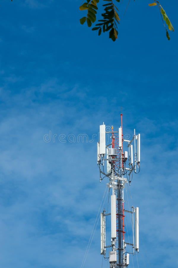 Mobile phone communication antenna tower with the blue sky and c stock images