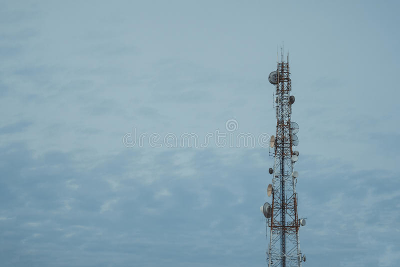 Mobile phone communication antenna tower with the blue sky and c royalty free stock image