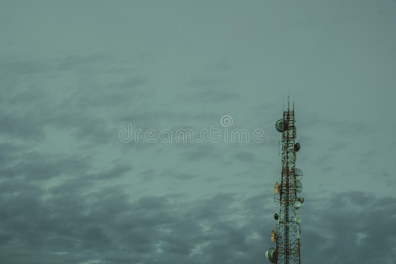 Mobile phone communication antenna tower with the blue sky and c royalty free stock photo