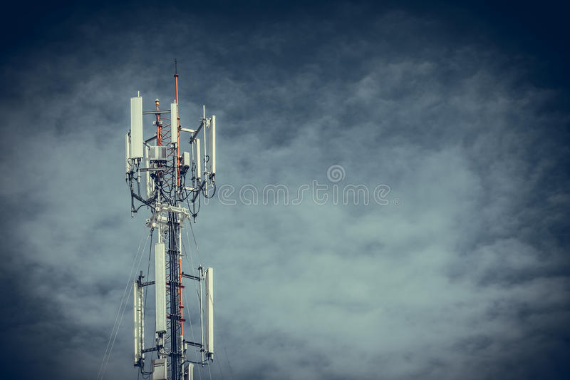 Mobile phone communication antenna tower with the blue sky and c stock photos