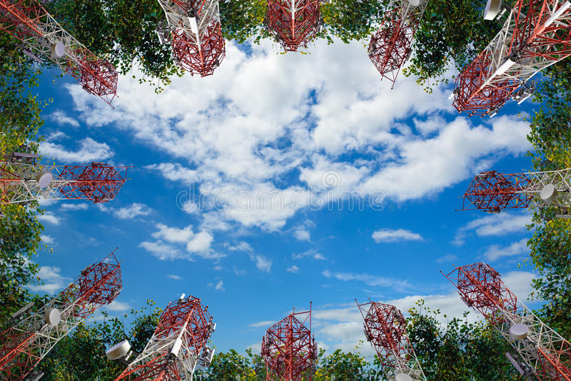 Mobile phone communication antenna tower and tree with cloud blu stock photo