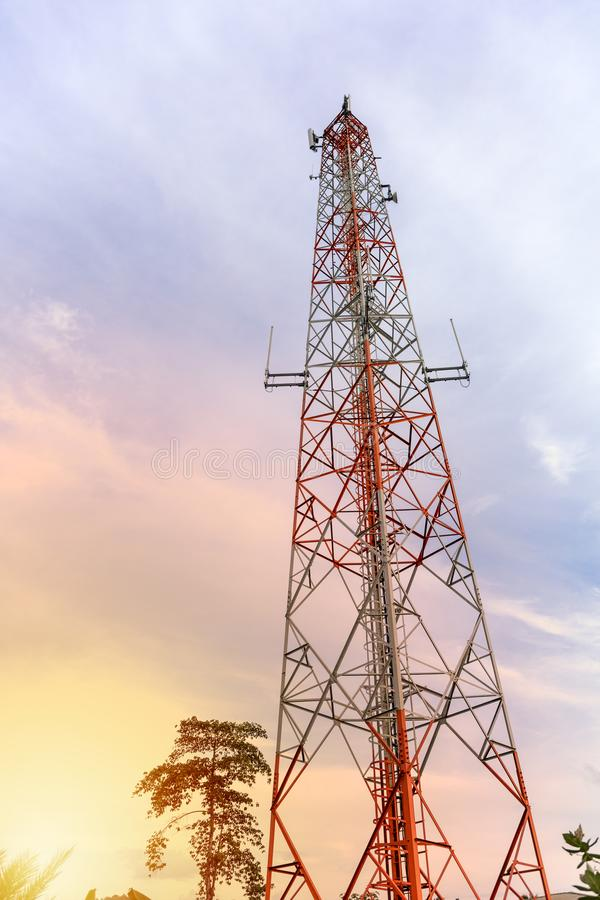 Mobile phone communication and network signal repeater antenna tower with blue sky background. Sun light effect. Technology concept. Mobile phone communication stock photography