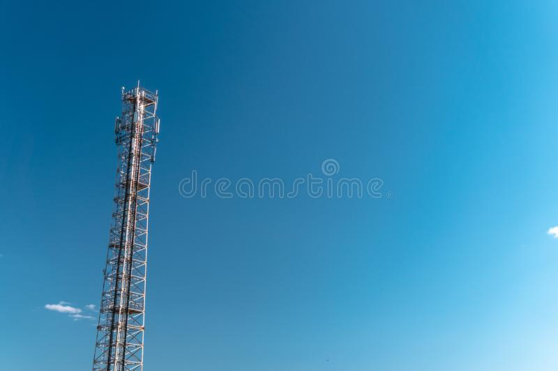 Mobile phone communication tower transmission signal with blue sky background and antenna, copy space stock images