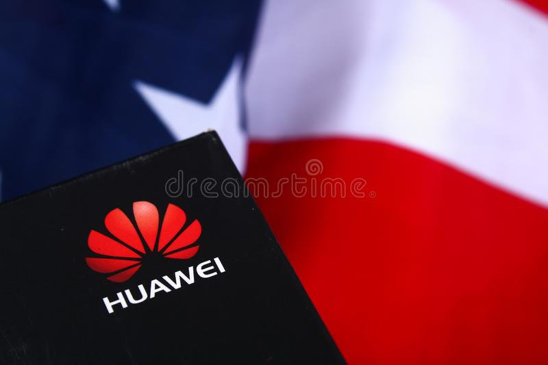 Mobile phone company Huawei on background of flag and USA dollars. confrontation countries US-China. Business. Stavropol, June royalty free stock photography