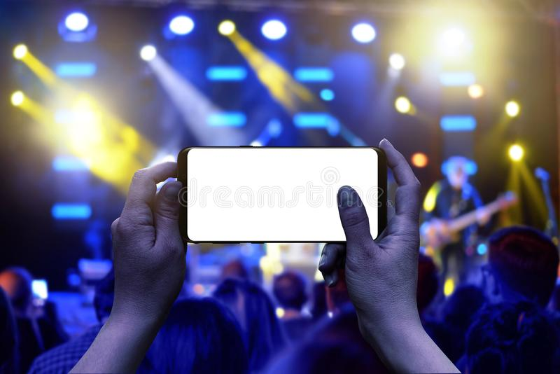Mobile phone with display in hands. Horizontal position royalty free stock photo