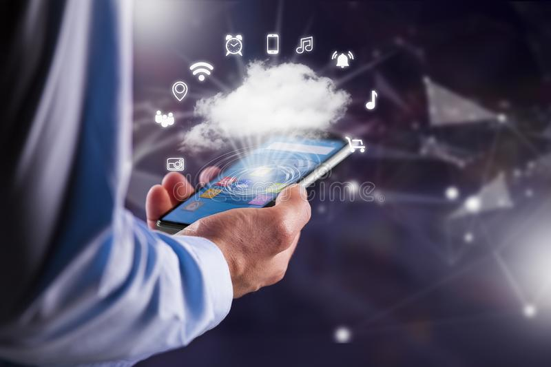 Mobile phone download information from cloud royalty free stock photo