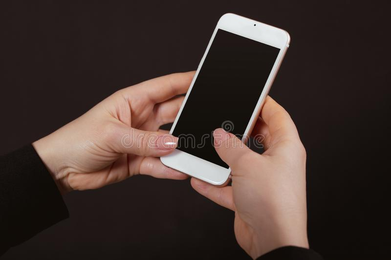 Mobile phone in female hands royalty free stock image