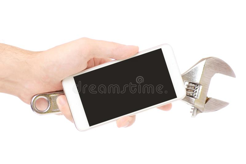Mobile phone in hand and tool repair royalty free stock photography